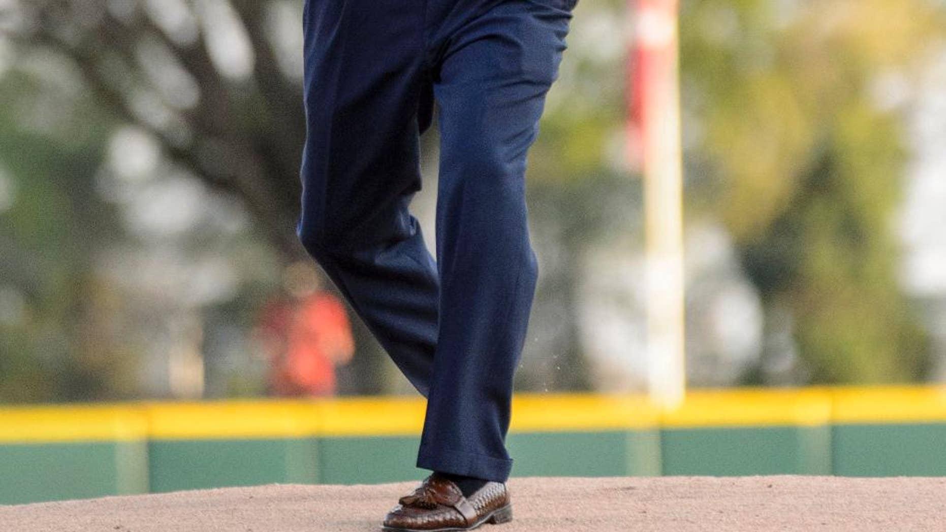 Alabama football coach Nick Saban throws out the ceremonial first pitch at an NCAA college baseball game between Alabama and Auburn, Friday, April 11, 2014, at Sewell-Thomas Stadium in Tuscaloosa, Ala. (AP Photo/Alabama Media Group, Vasha Hunt) MAGAZINES OUT