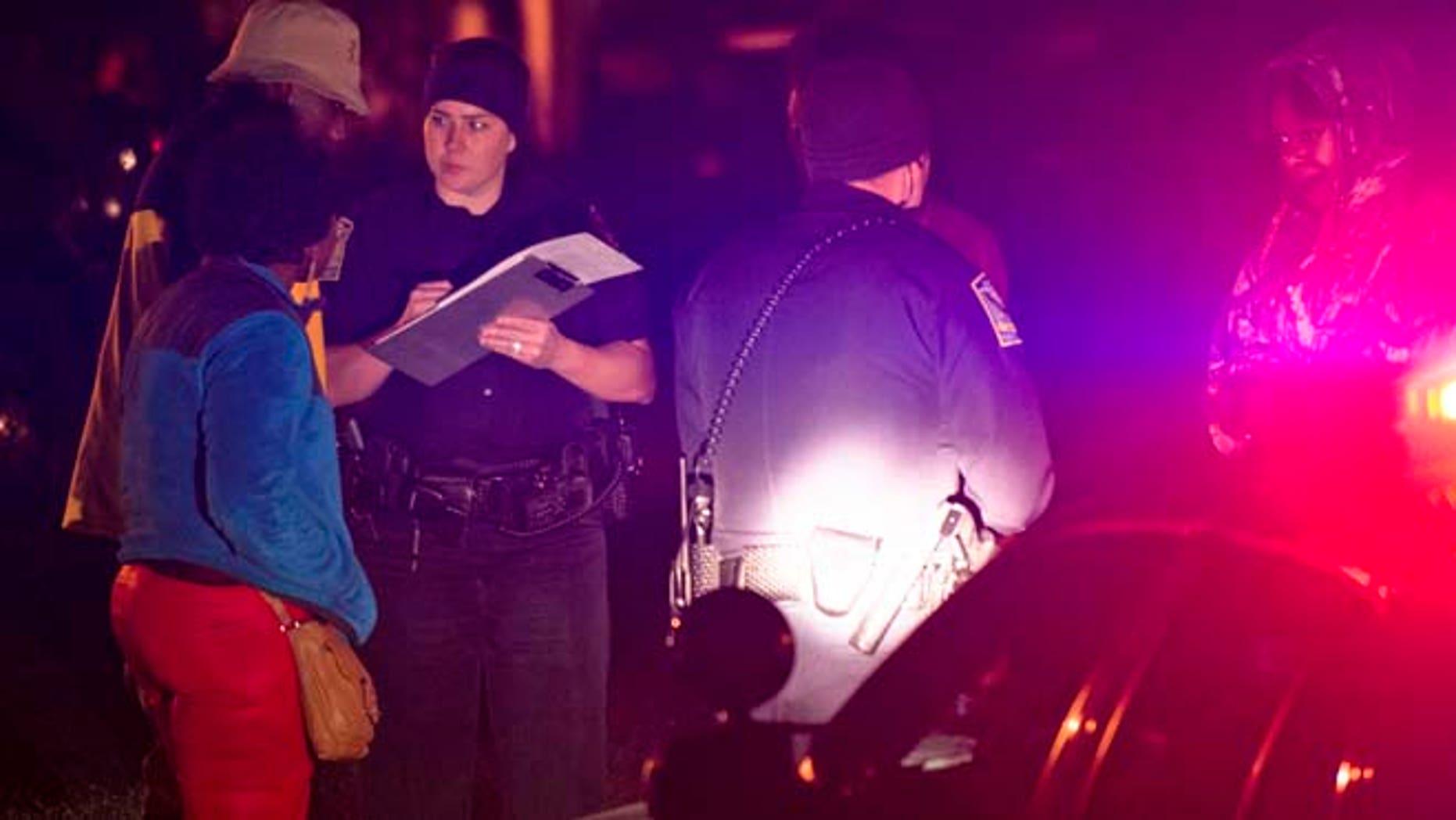 Dec. 14, 2014: Auburn Police investigate a shooting at the Tiger Lodge apartments in Auburn, Ala. (AP/Montgomery Advertiser/Albert Cesare)