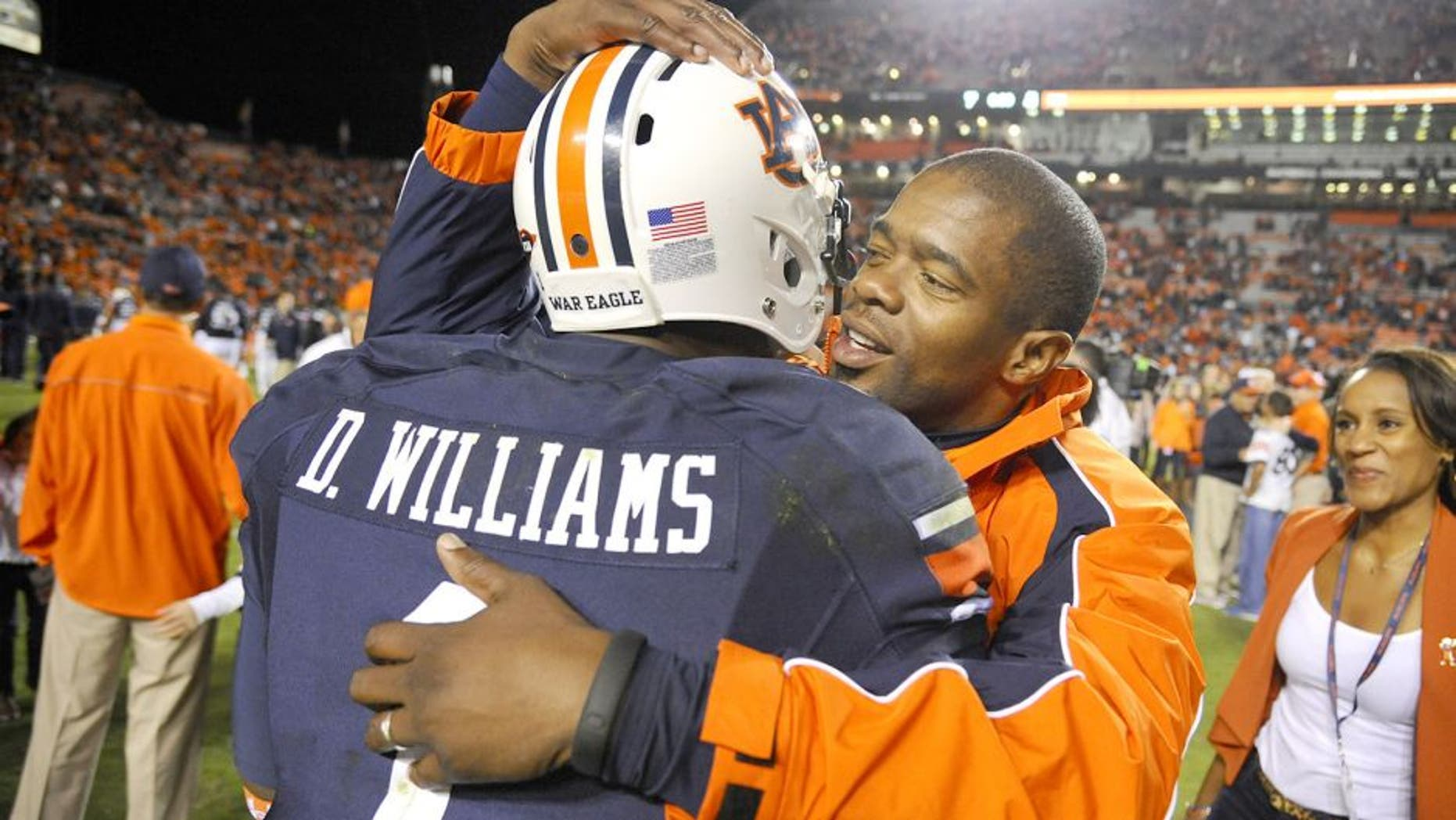 Oct 4, 2014; Auburn, AL, USA; Auburn Tigers wide receiver D'haquille Williams (1) hugs co-offensive coordinator Dameyune Craig after the game against the LSU Tigers at Jordan Hare Stadium. Auburn won 41-7. Mandatory Credit: Shanna Lockwood-USA TODAY Sports