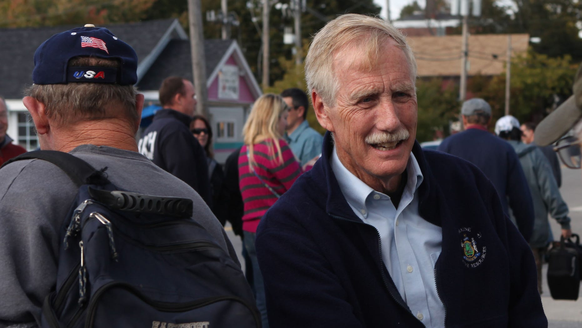 FILE: Oct. 1, 2012: U.S. Senate candidate Angus King greets workers leaving Bath Iron Works, in Bath, Maine.