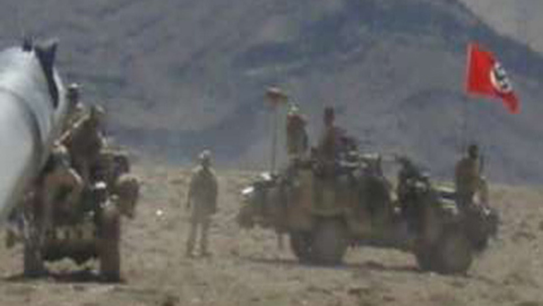 This photo showing Australian Special Forces troops flying a Nazi flag from a vehicle while on patrol in Afghanistan in 2007 has just become public.