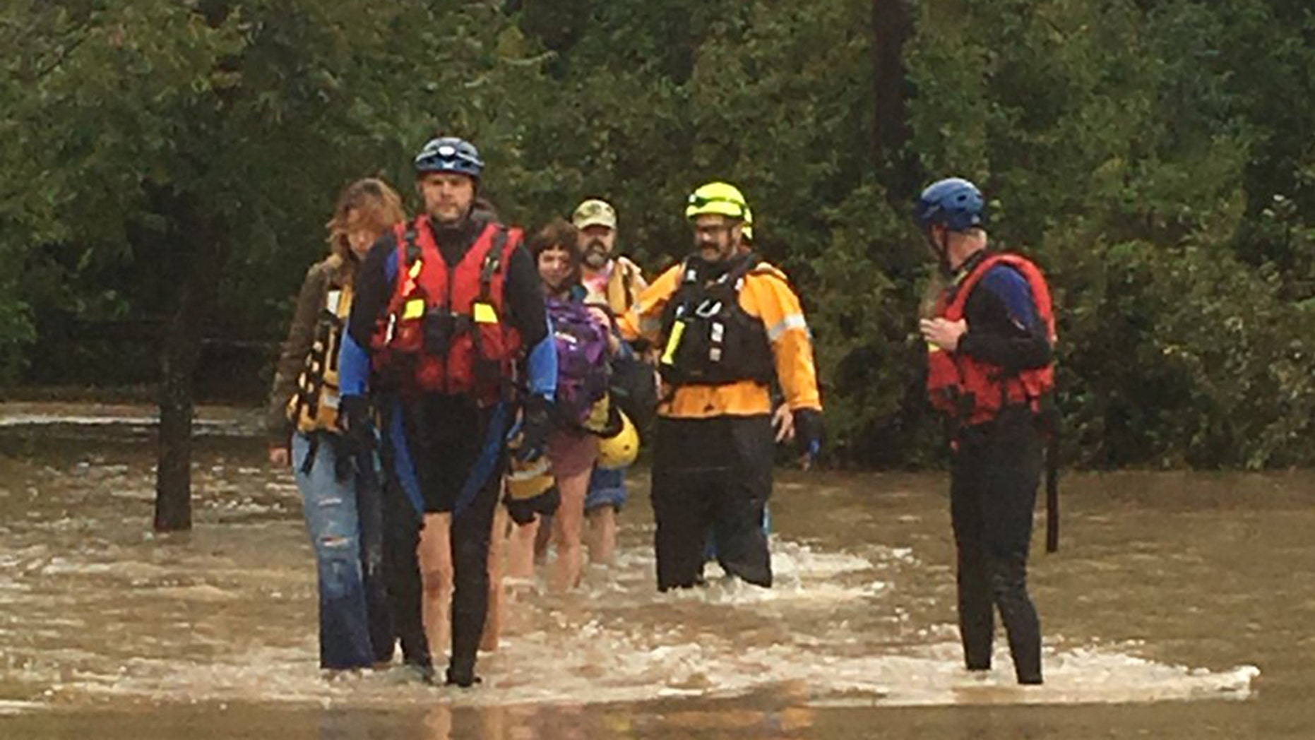 At least 60 people from a wedding party had to be rescued Saturday by rising floodwaters in Texas.