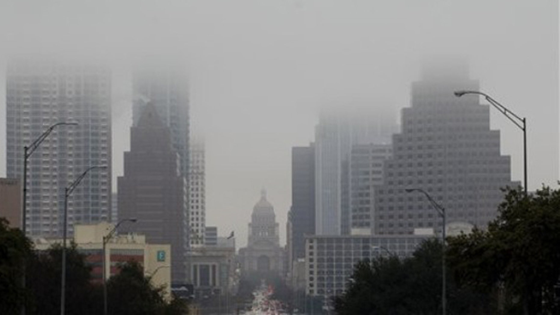 Jan. 24, 2012: The Texas Capitol and downtown buildings fade into the fog in Austin, Texas.