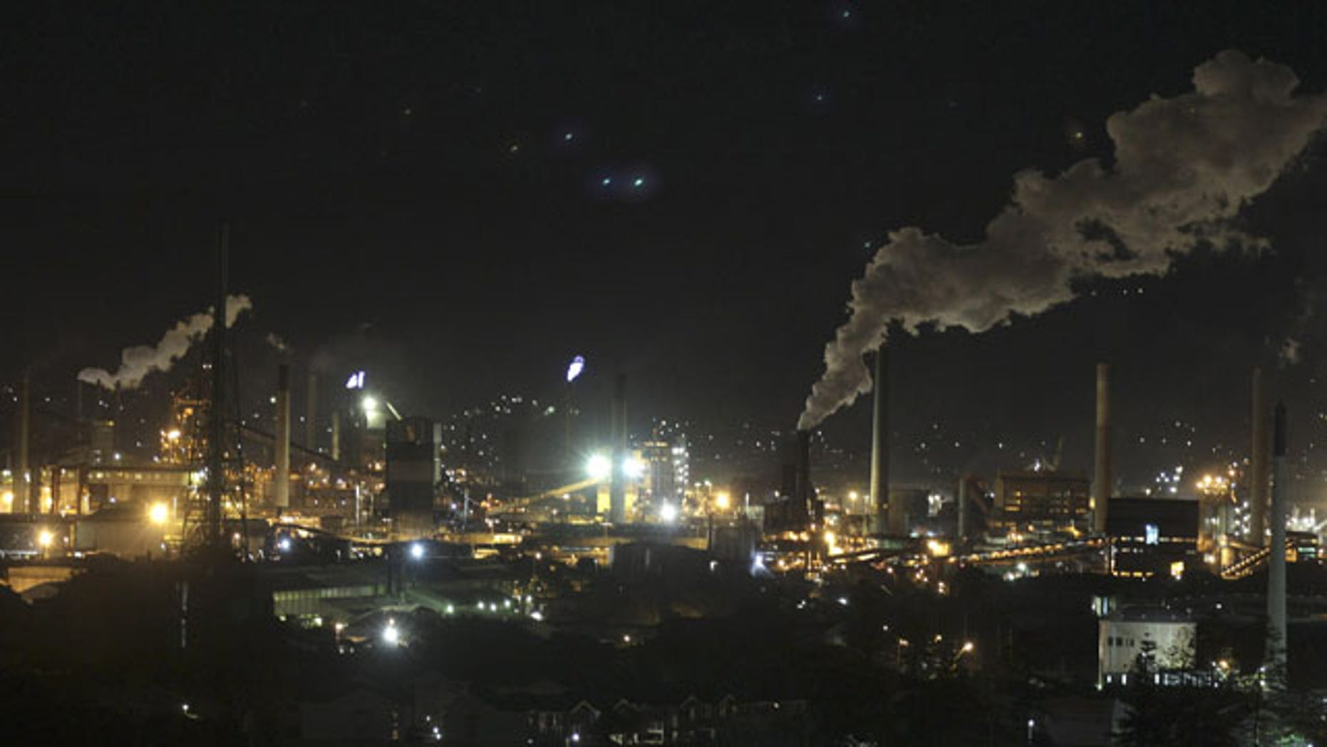 In this Friday, July 8, 2011 file photo, smoke bellows out of a chimney stack at Bluescope Steel works at Port Kembla, south of Sydney, Australia. (AP Photo/Rob Griffith, File)