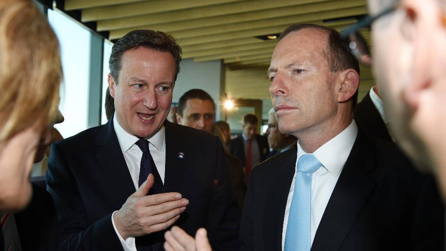 Nov. 14, 2014: British Prime Minister David Cameron, left, gestures as he stands with Australian Prime Minister Tony Abbott as the speak with guests at an infrastructure business breakfast in Sydney, Australia