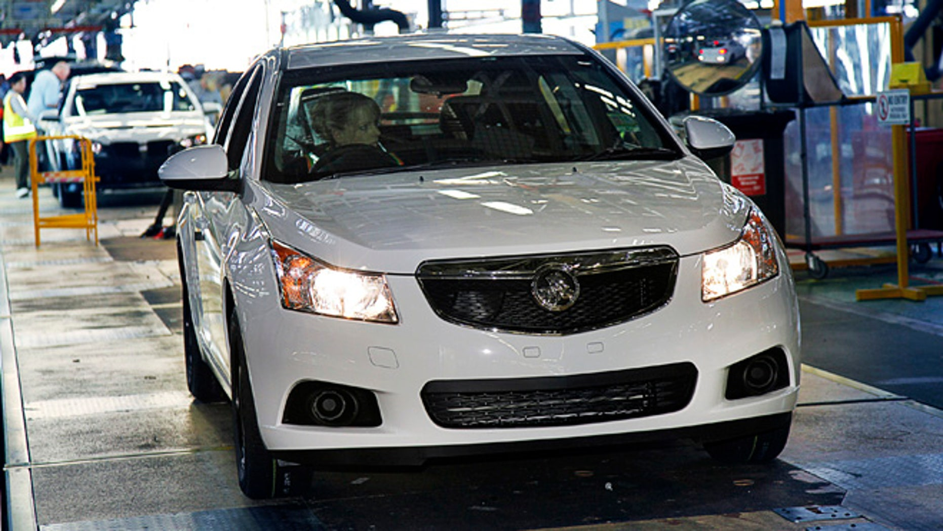 FILE - In this undated file photo released by General Motors Co., a Holden Cruze hatch is driven off the assembly line after it was manufactured at a plant in Australia. General Motors Co. said Wednesday, Dec. 11, 2013, it will stop making cars and engines in Australia by the end of 2017, with nearly 2,900 jobs to be lost, because of high production costs and competition. GM's Australian subsidiary Holden once dominated Australian auto sales, but lost market share to imported cars. (AP Photo/General Motors, File)