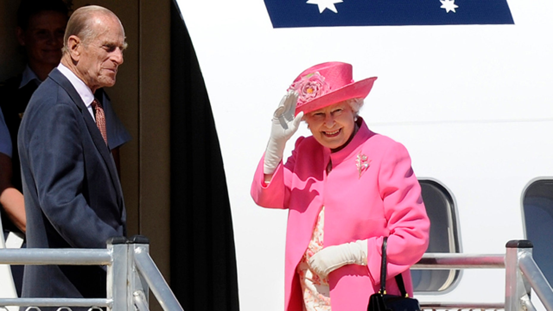 FILE - In this Oct. 26, 2011 file photo, Britain's Queen Elizabeth II, right, and her husband Prince Philip board a plane flying to Perth from Melbourne airport, Australia, on their way to attend the Commonwealth heads of government meeting in Perth. (AP Photo/Andrew Brownbill, File)