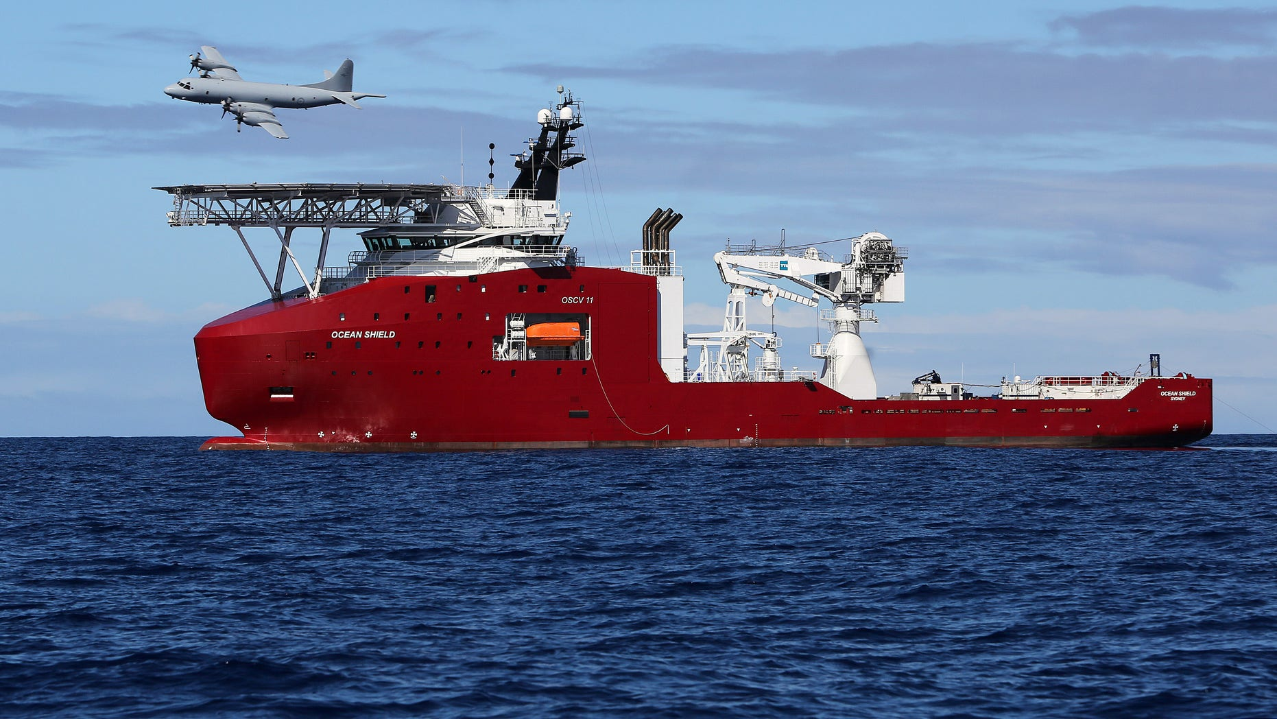 April 9, 2014 - Royal Australian Air Force AP-3C Orion flies past Australian Defense vessel Ocean Shield on a mission to drop sonar buoys to assist in the acoustic search of the missing Malaysia Airlines Flight 370 in the southern Indian Ocean.
