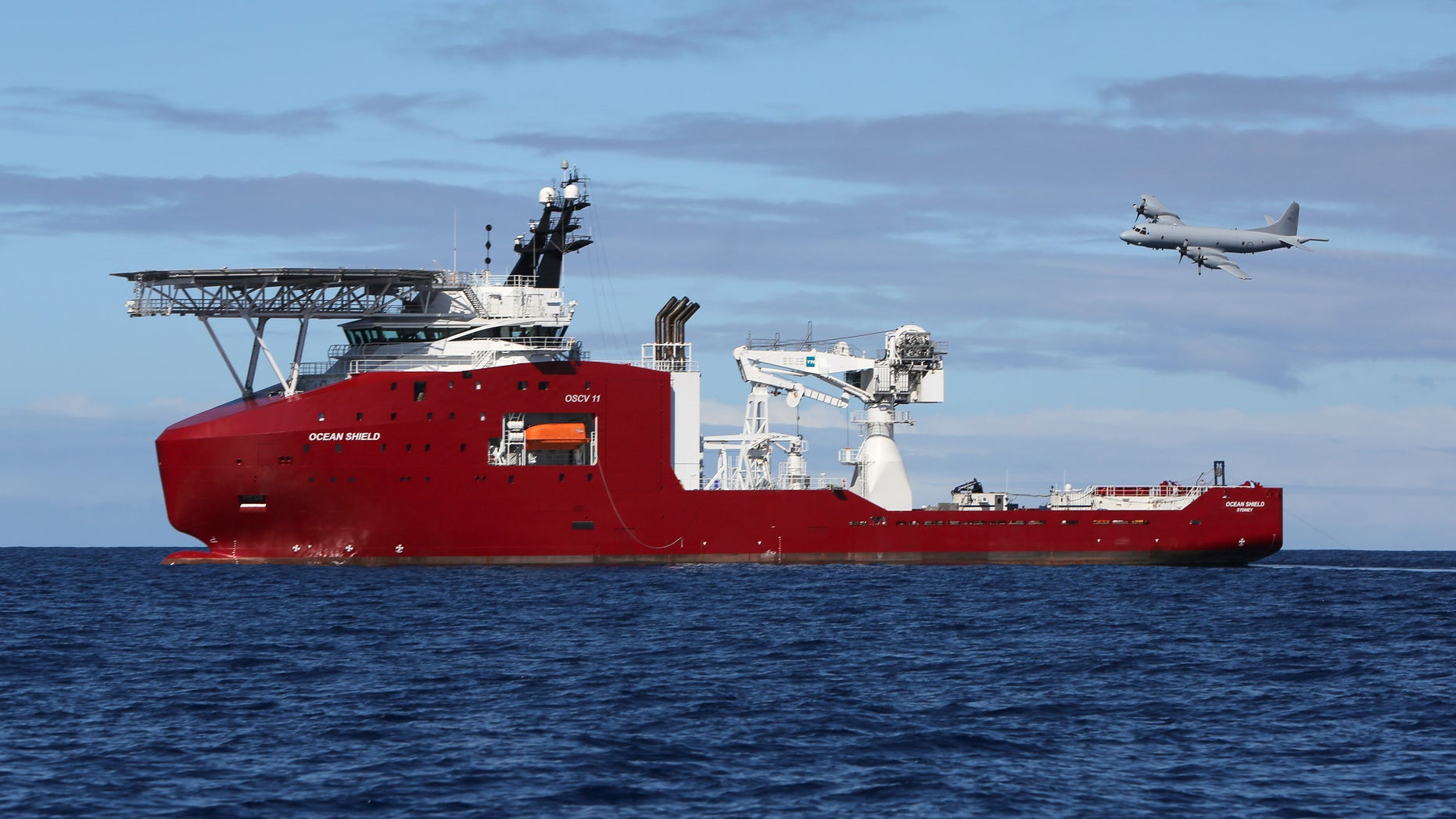 In this April 9, 2014 photo provided by the Australian Defense Force, a Royal Australian Air Force AP-3C Orion flies past Australian Defense vessel Ocean Shield on a mission to drop sonar buoys to assist in the acoustic search of the missing Malaysia Airlines Flight 370 in the southern Indian Ocean. The ship searching for the missing Malaysian jet has detected two more underwater signals that may be emanating from the aircraft's black boxes, and the Australian official in charge of the search expressed hope Wednesday that the plane's wreckage will soon be found.   (AP Photo/Australian Defense Force, LSIS Bradley Darvill) EDITORIAL USE ONLY