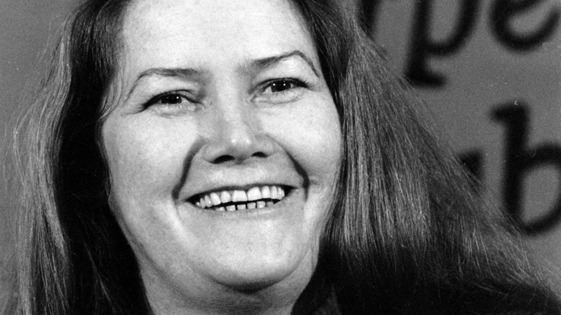 Australian-born author Colleen McCullough laughs during a news conference in New York on Tuesday, March 1, 1977.