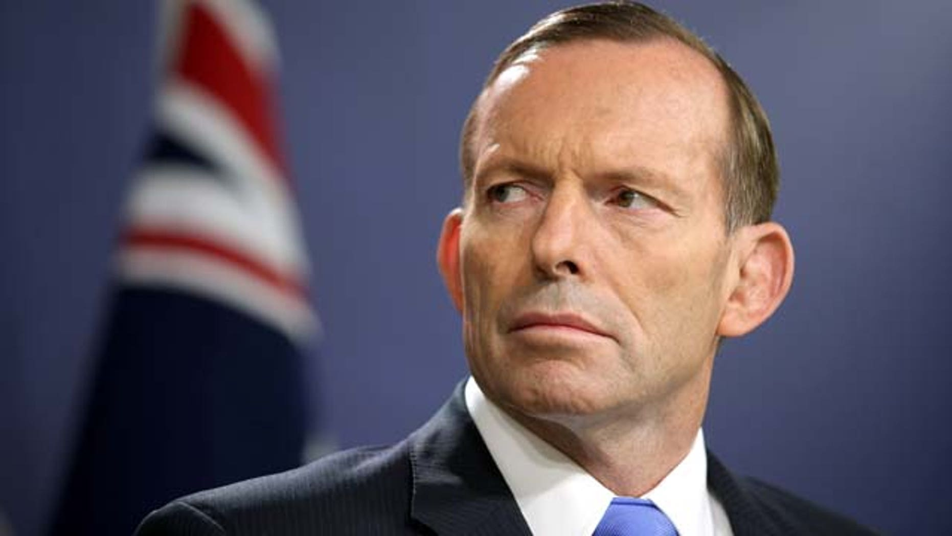 FILE - In this Sept. 19, 2014 file photo, Australian Prime Minister Tony Abbott speaks during a press conference, in Sydney.  (AP Photo/Rick Rycroft, File)