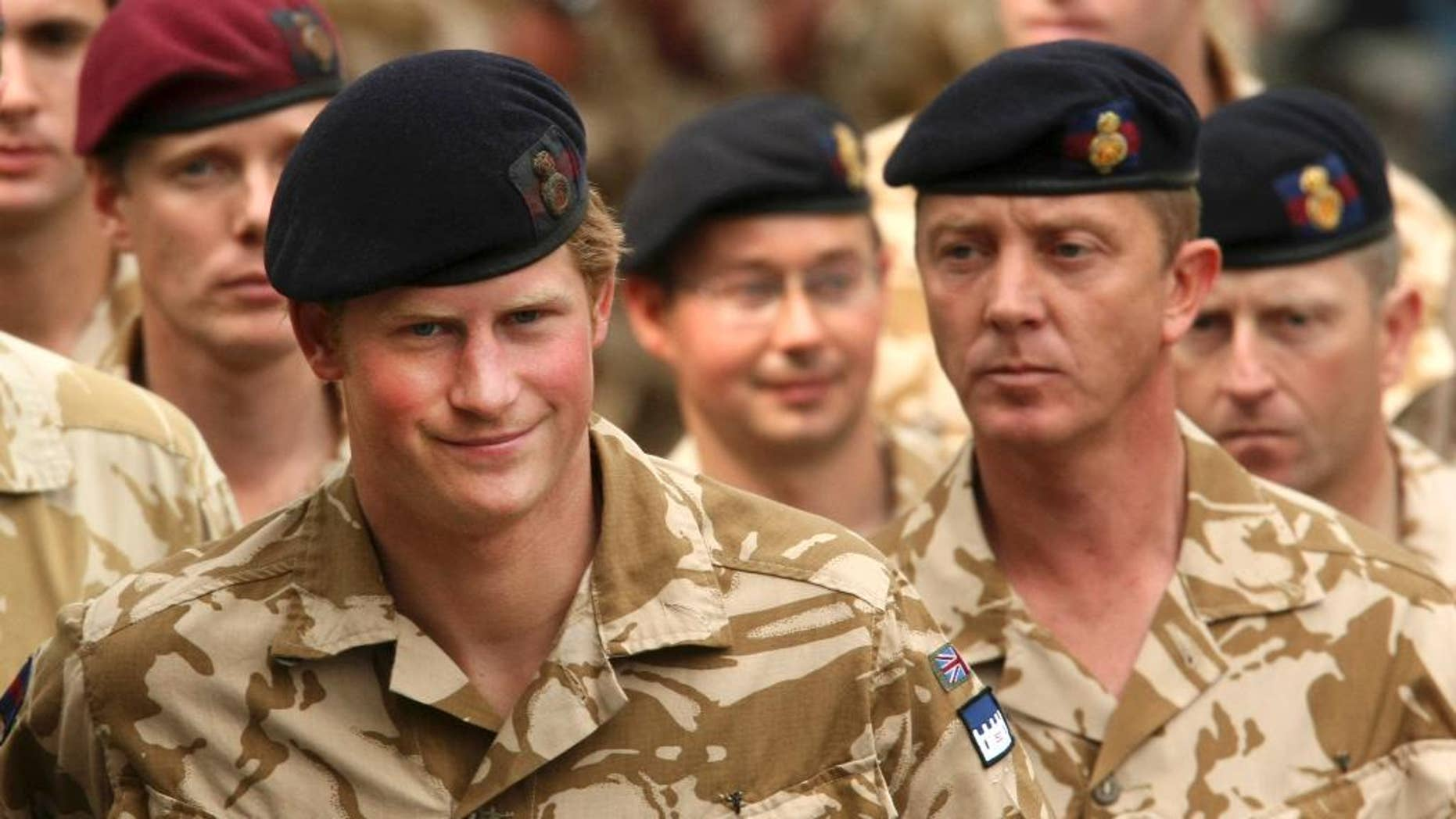 File-This May 5, 2008, file photo shows Britain's Prince Harry, left, arriving for a thanksgiving service at the Army Garrison Church in Windsor, England, after receiving a campaign medal for serving in Afghanistan. Prince Harry will be embedded in Australian army units on the north, west and east coasts of the country during the British royal's hectic four-week secondment to the Australian defense forces next month before he ends his decade-long military career, officials said Tuesday, March 17, 2015. (AP Photo/Matt Dunham, File)