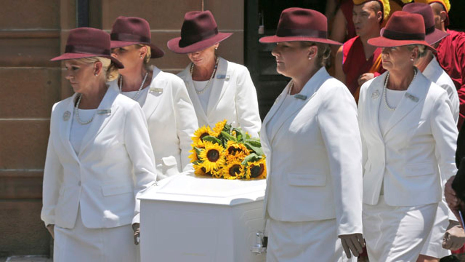 Dec. 23, 2014: White Lady funeral directors carry the coffin of Tori Johnson during a funeral service in Sydney, Australia. Johnson was one of three people, including the gunman, who were killed during a siege in the Lindt cafe coffee shop in Sydney last week.(AP Photo/Rob Griffith)