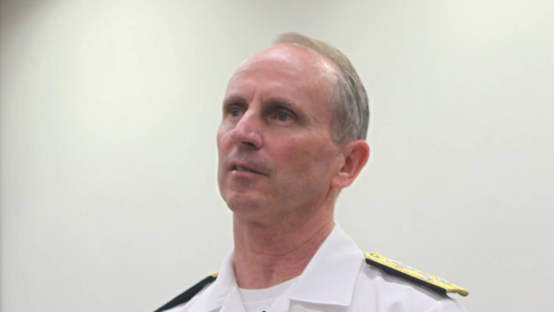 In this photo released by the Australian National University, U.S. Navy Adm. Jonathan Greenert speaks during a lecture at the ANU in Canberra, Australia Tuesday, Feb. 10, 2015. Greenert, who as chief of Naval Operations sets the navy's future strategy, said Tuesday lasers that shoot down drones with precision and electromagnetic cannons that fire more than 100 miles are part of the future of naval warfare, promising to be cheaper to use than conventional weapons. (AP Photo/The Australian National University, Kate Hulm)