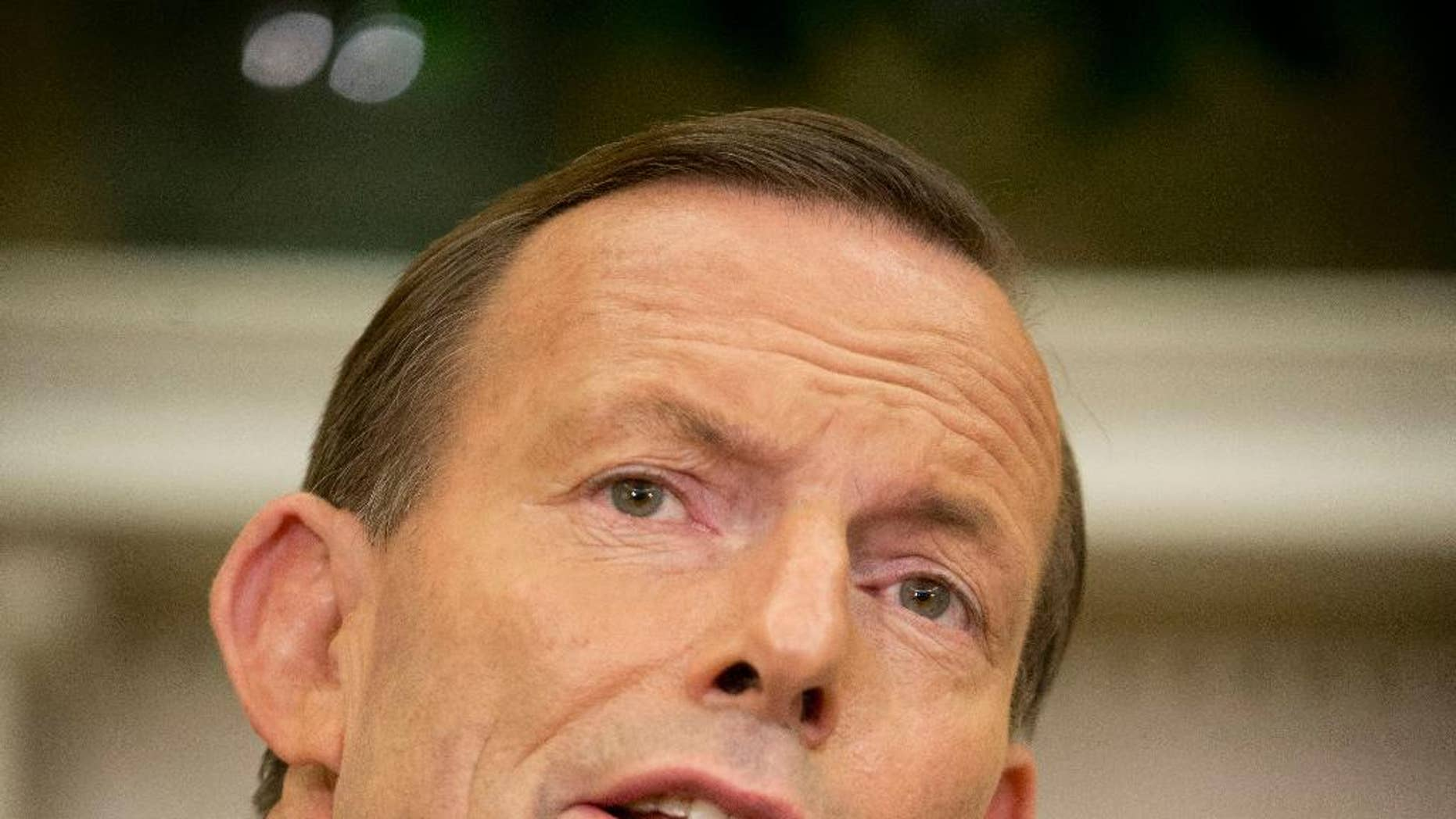 FILE - Australian Prime Minister Tony Abbott speaks during his meeting with President Barack Obama, in this Thursday, June 12, 2014 file photo taken in the Oval Office of the White House in Washington. Abbott on Saturday July 19, 2014 called for an independent, international investigation into the downing of a Malaysian jetliner in Ukraine and demanded Russia's full cooperation. (AP Photo/Pablo Martinez Monsivais, File)