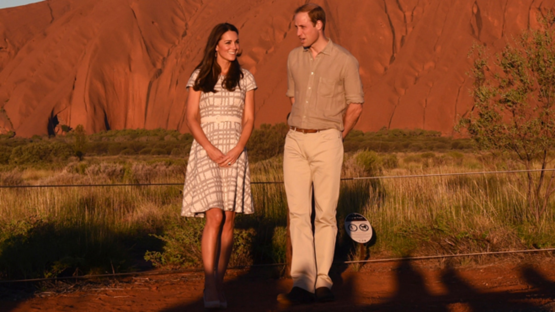 April 22, 2014: Britain's Prince William and his wife, Kate, Duchess of Cambridge, pose for a photo at sunset in Uluru, Australia.