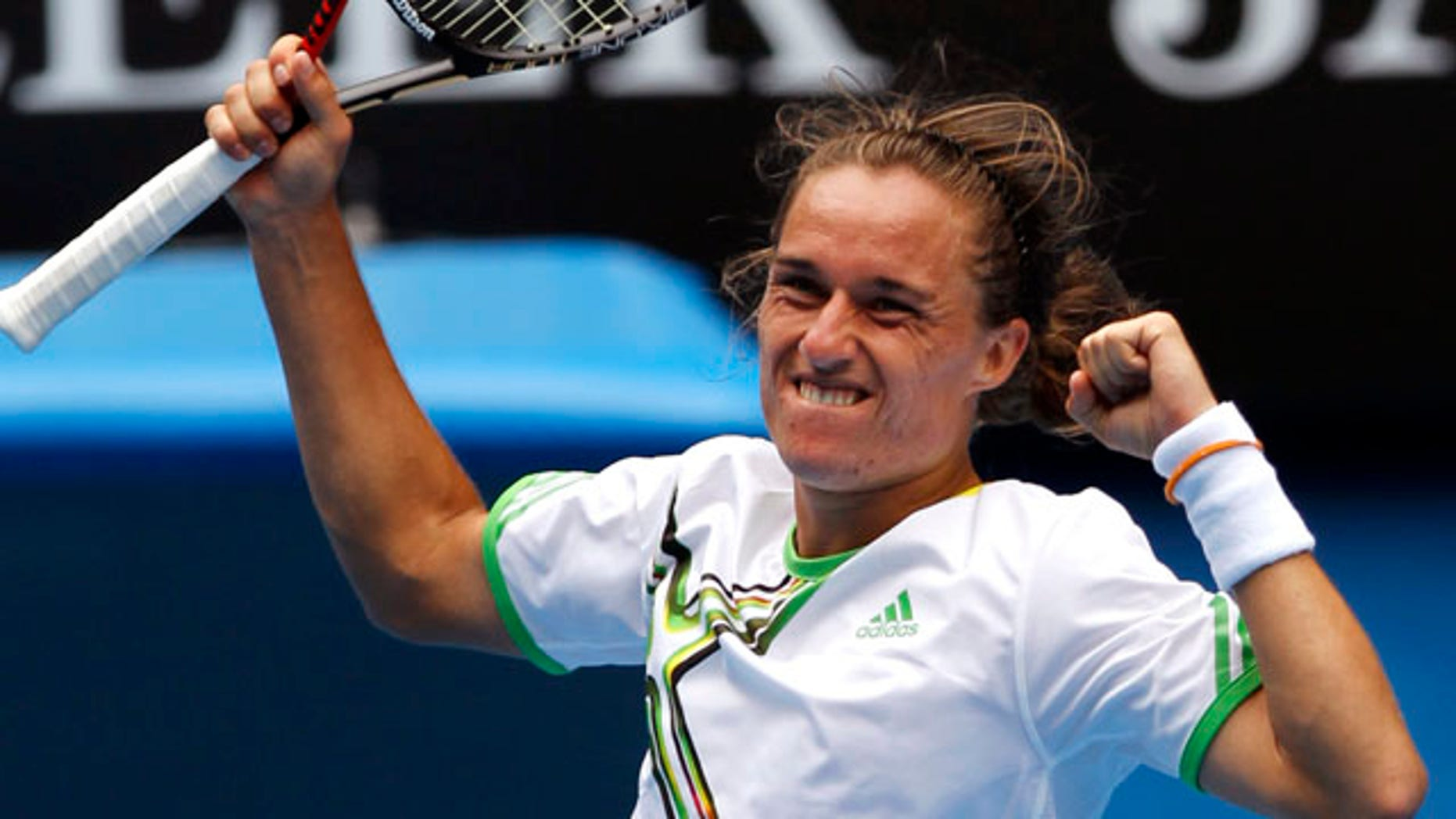 Jan. 24: Alexandr Dolgopolov of Ukraine celebrates after beating Robin Soderling of Sweden in their fourth round match at the Australian Open tennis championships in Melbourne, Australia.