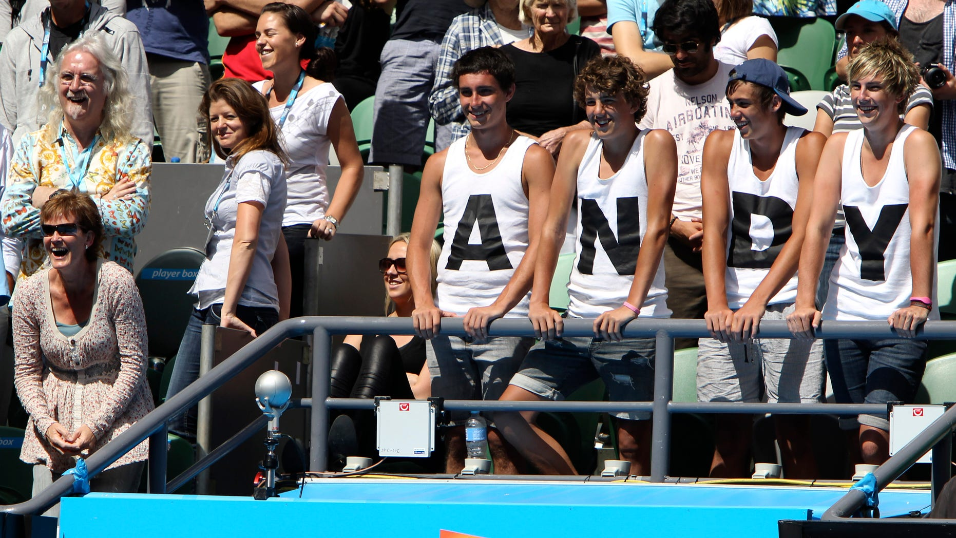 Jan. 24: Scottish comedian Billy Connolly, top left, and Judy Murray, bottom left, stand with supporters of Britain's Andy Murray as he is interviewed after beating Austria's Jurgen Melzer in the fourth round match at the Australian Open tennis championships in Melbourne, Australia.