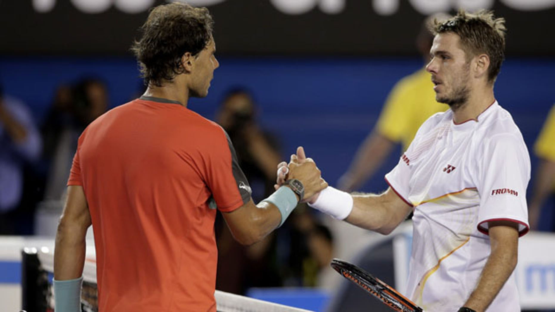 January 26, 2014: Stanislas Wawrinka of Switzerland, right, shakes hands with Rafael Nadal of Spain at the net after Wawrinka won the men's singles final at the Australian Open tennis championship in Melbourne.(AP Photo/Rick Rycroft)