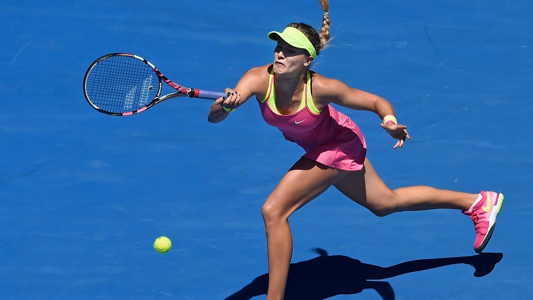Jan. 23, 2015 - Eugenie Bouchard of Canada chases down a shot to Caroline Garcia of France during their third round match at the Australian Open tennis championship in Melbourne, Australia Friday.