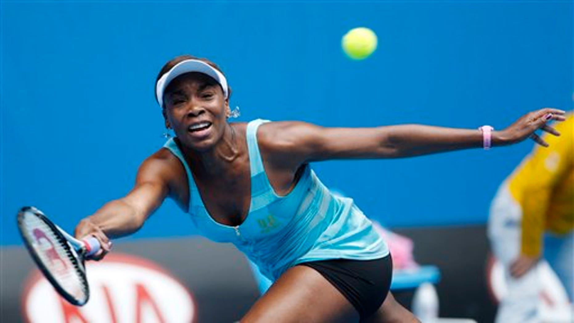 Venus Williams of the U.S. makes a forehand return to Italy's Sara Errani during their first round match at the Australian Open tennis championships in Melbourne, Australia, Monday, Jan. 17, 2011.   (AP Photo/Rob Griffith)