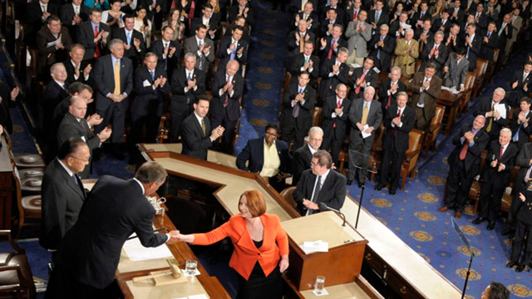 March 9: Australian Prime Minister Julia Gillard shakes hands with Speaker of the House John Boehner, R-Ohio, second from left, after addressing a joint meeting of Congress on Capitol Hill in Washington, D.C.