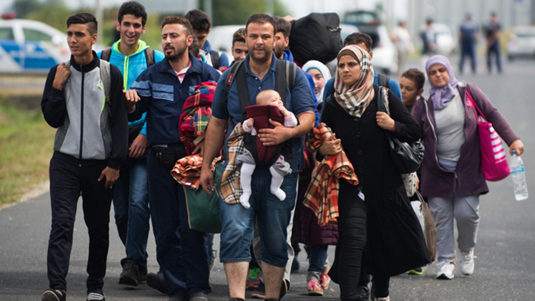 Sept. 14, 2015: Refugees arrive at the border between Austria and Hungary near Heiligenkreuz.