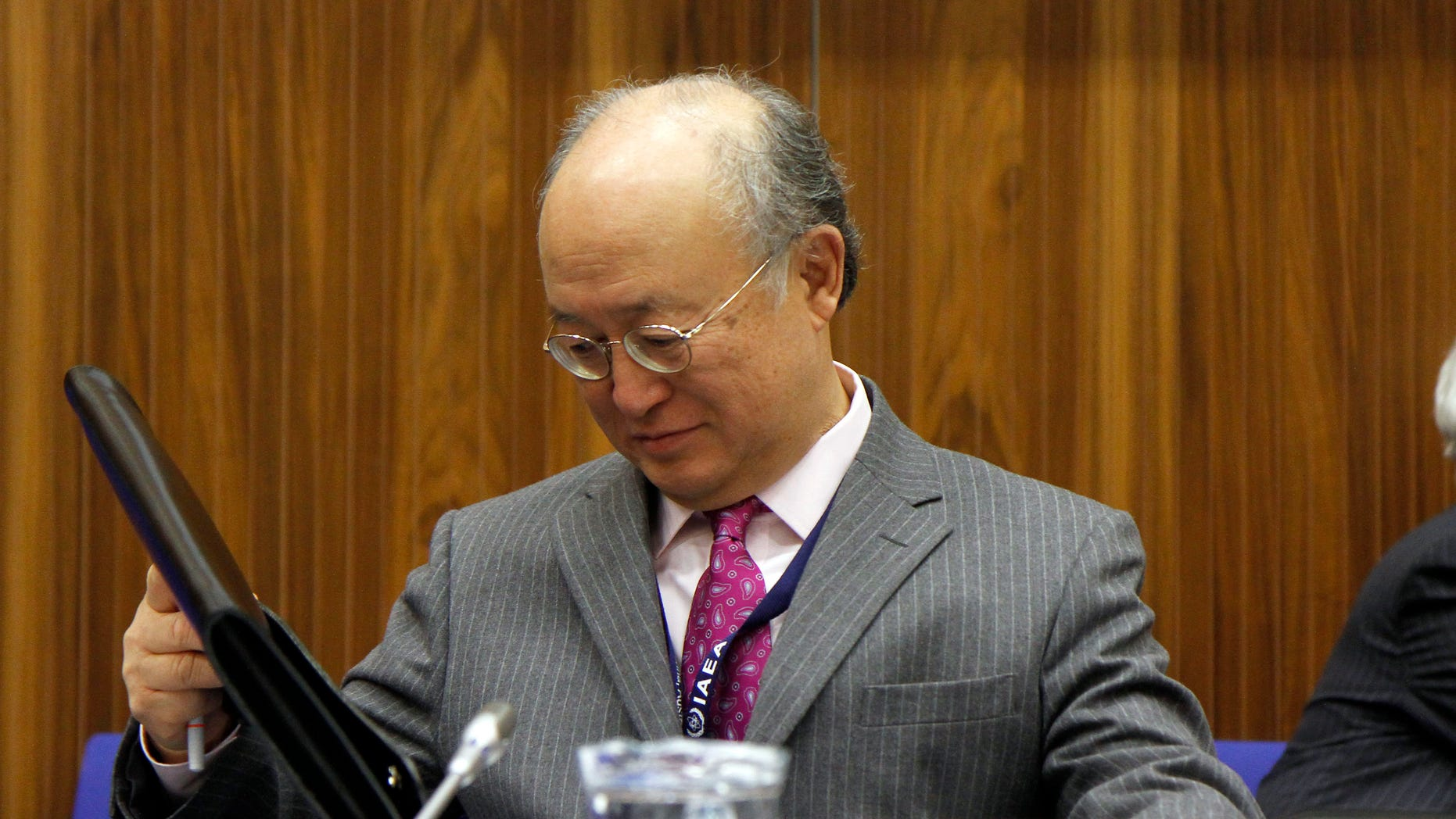 Dec. 3: Director General of the International Atomic Energy Agency, IAEA, Yukiya Amano from Japan, waits for the start of the IAEA's board of governors meeting at the International Center in Vienna, Austria.