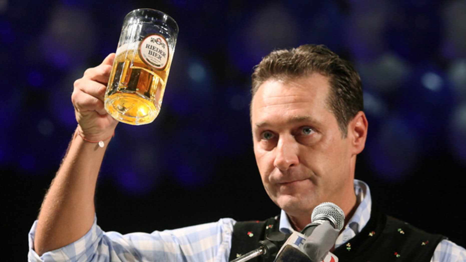 Feb. 22, 2012: In this file photo head of the Austrian right-wing Freedom Party Heinz-Christian Strache lifts a glass of beer during his traditional Ash Wednesday speech in Ried, Austria.