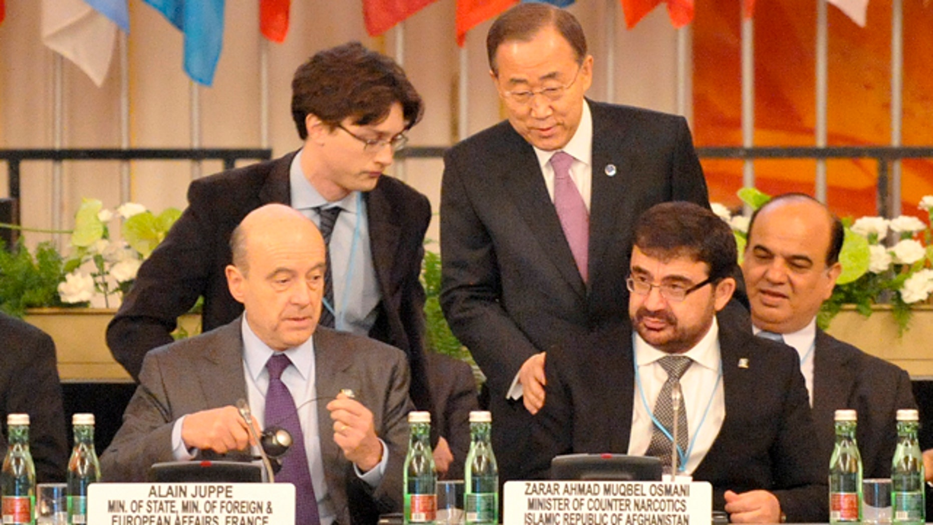 Thursday, Feb. 16, 2012- UN Secretary General Ban Ki-moon, center right, welcomes the Afghan Minister of Counter Narcotics Zarar Ahmed Muqbel Osmani, right, and French Foreign Minister Alain Juppe, left, at the third Ministerial Conference of the Paris Pact Partners in Vienna, Austria.