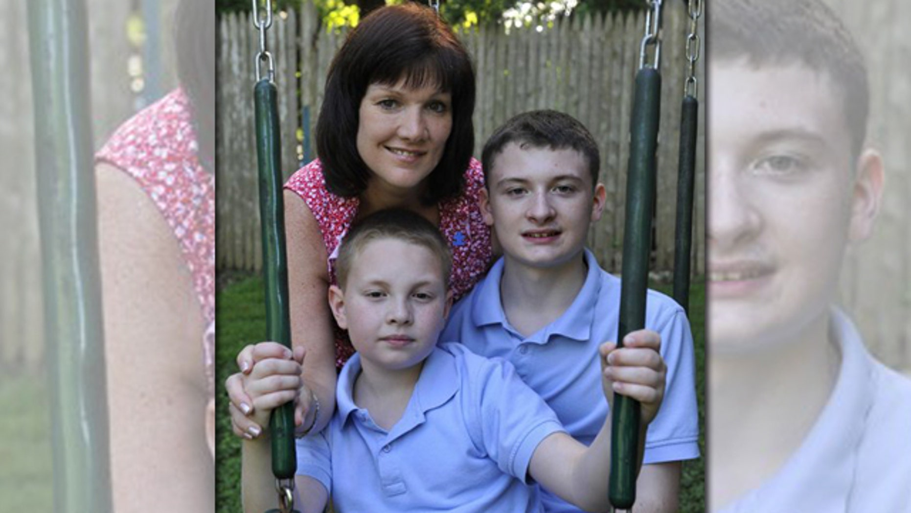 Kathleen Lanese of Kings Park, N.Y., poses with her two autistic sons Brendan, 14, right and Kevin, 10 at her sister-in-law's home on Thursday, Aug. 11, 2011, in Oyster Bay, N.Y. Lanese says having one son with autism didn't make her think twice about trying to have another child, even though she knew there was a chance the second would be affected, too.