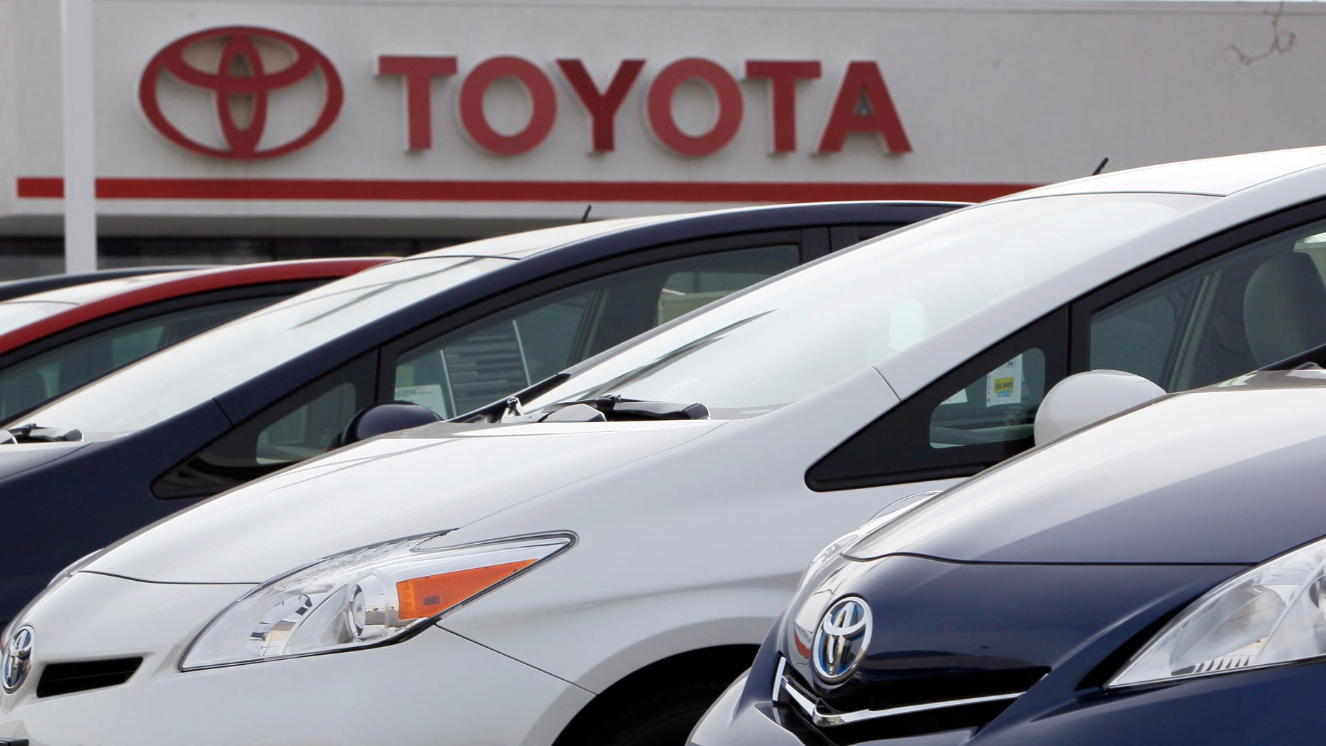 This Feb. 19, 2012 file photo shows a line of 2012 Prius sedans at a Toyota dealership in the south Denver suburb of Littleton, Colo. Toyota and Chrysler saw big U.S. sales gains in April 2012, but they came at the expense of General Motors and Ford. Toyota said its sales rose 12 percent as its inventories finally return to pre-earthquake levels. (AP Photo/David Zalubowski)