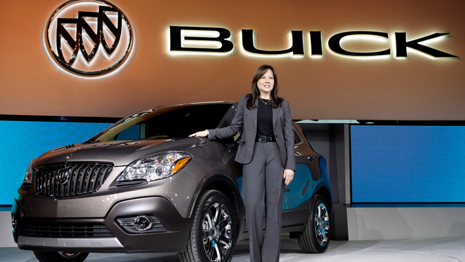 FILE - In this Jan. 10, 2012 file photo, Mary Barra, then General Motors Senior Vice President, Global Product Development, introduces the 2013 Buick Encore at the North American International Auto Show in Detroit. Buick, the brand that once was the pace car for the drive to the senior center, has made a comeback by appealing to buyers not yet ready for retirement. (AP Photo/Paul Sancya, File)