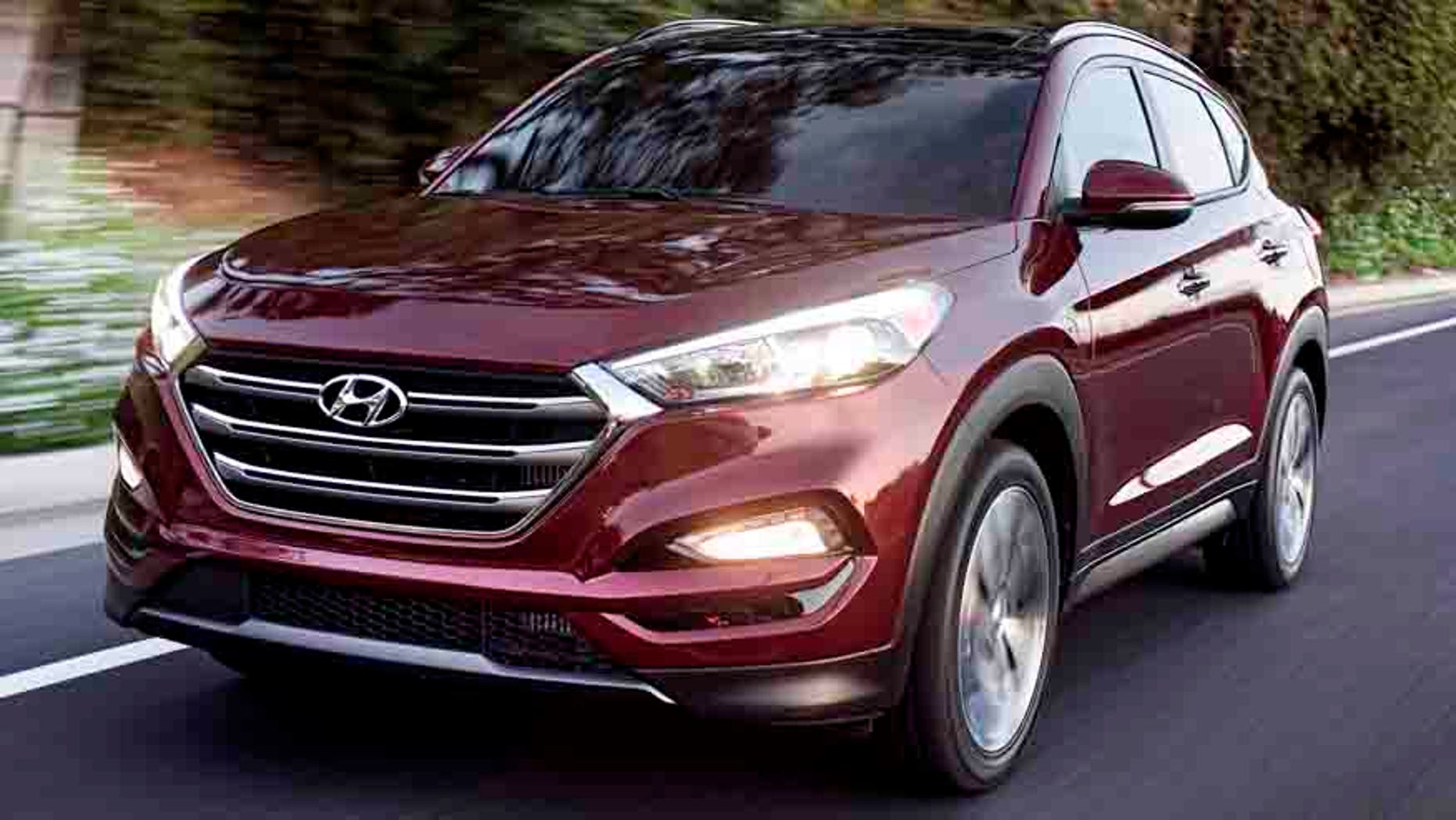 FILE - This photo provided by Hyundai Motor America shows the 2016 Hyundai Tucson.  Small SUVs did poorly in new headlight tests performed by the insurance industry. The Insurance Institute for Highway Safety says none of the 21 small SUVs tested earned its highest ranking. The Ford Escape, Honda CR-V, Hyundai Tucson and Mazda CX-3 performed best, but more than half the SUVs tested received the lowest ranking, including the Subaru Forester and the Audi Q3.(Morgan Segal/Hyundai Motor America via AP)