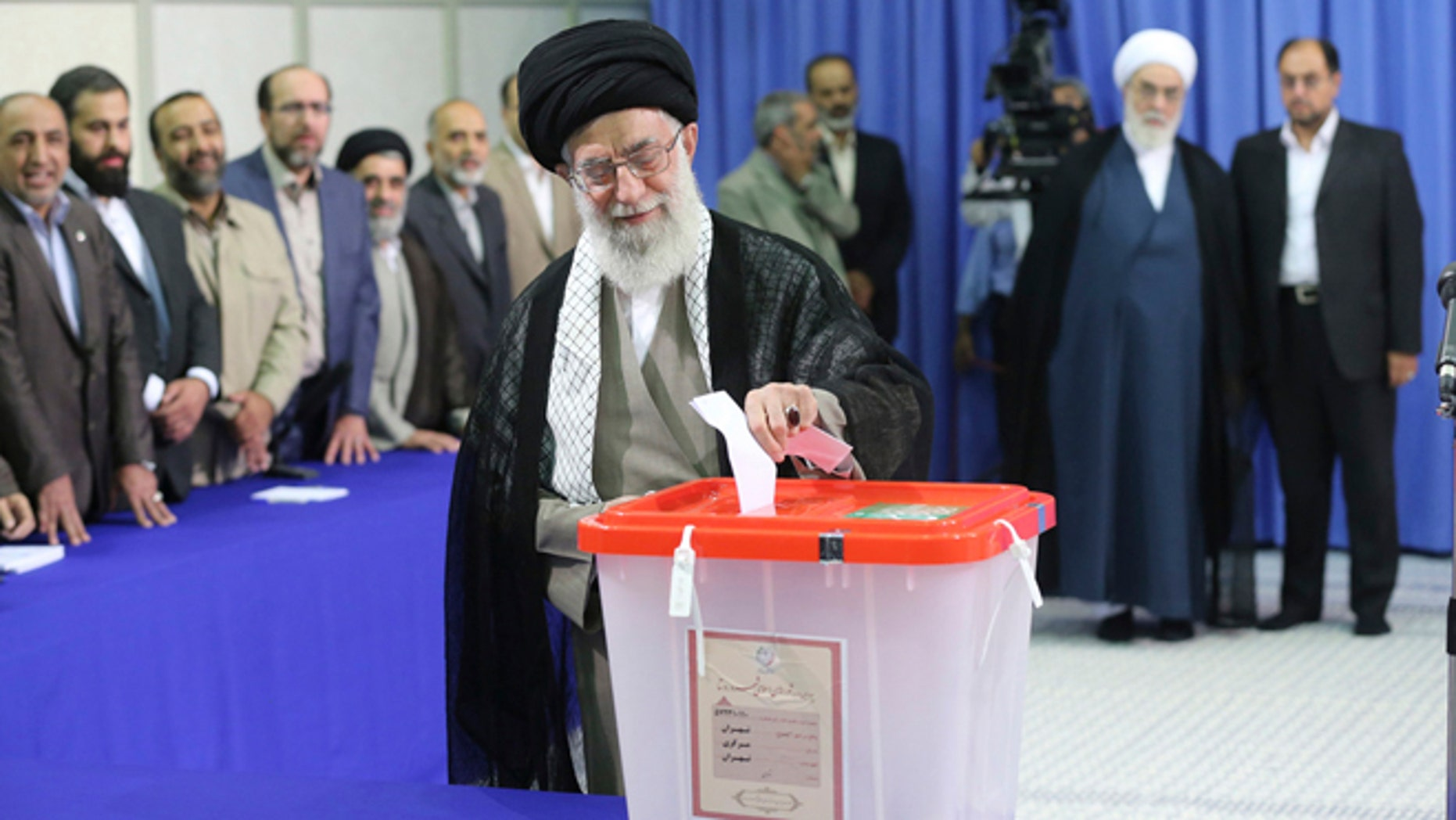 In this June 14, 2013 file photo, Iran's Supreme Leader Ayatollah Ali Khamenei casts his ballot at his office during the Iranian presidential election in central Tehran.