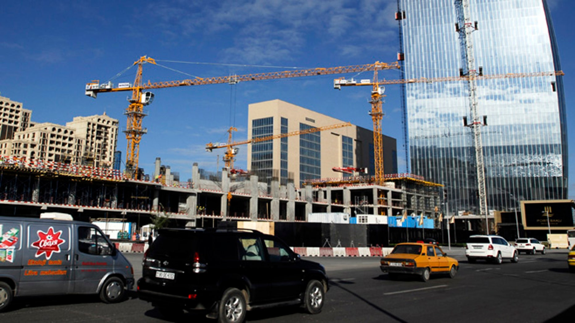 Nov. 3, 2012: Cars drive past buildings which are under construction in Azerbaijan's capital Baku.