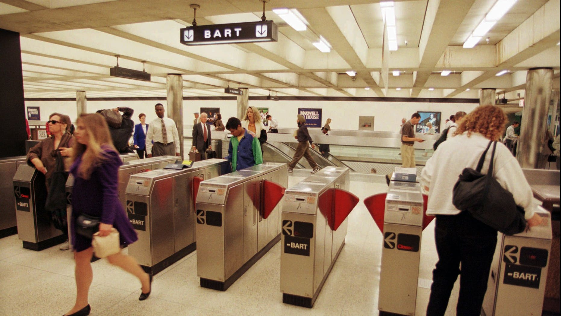 Commuters enter and exit a Bay Area Rapid Transit station in San Francisco's financial district.
