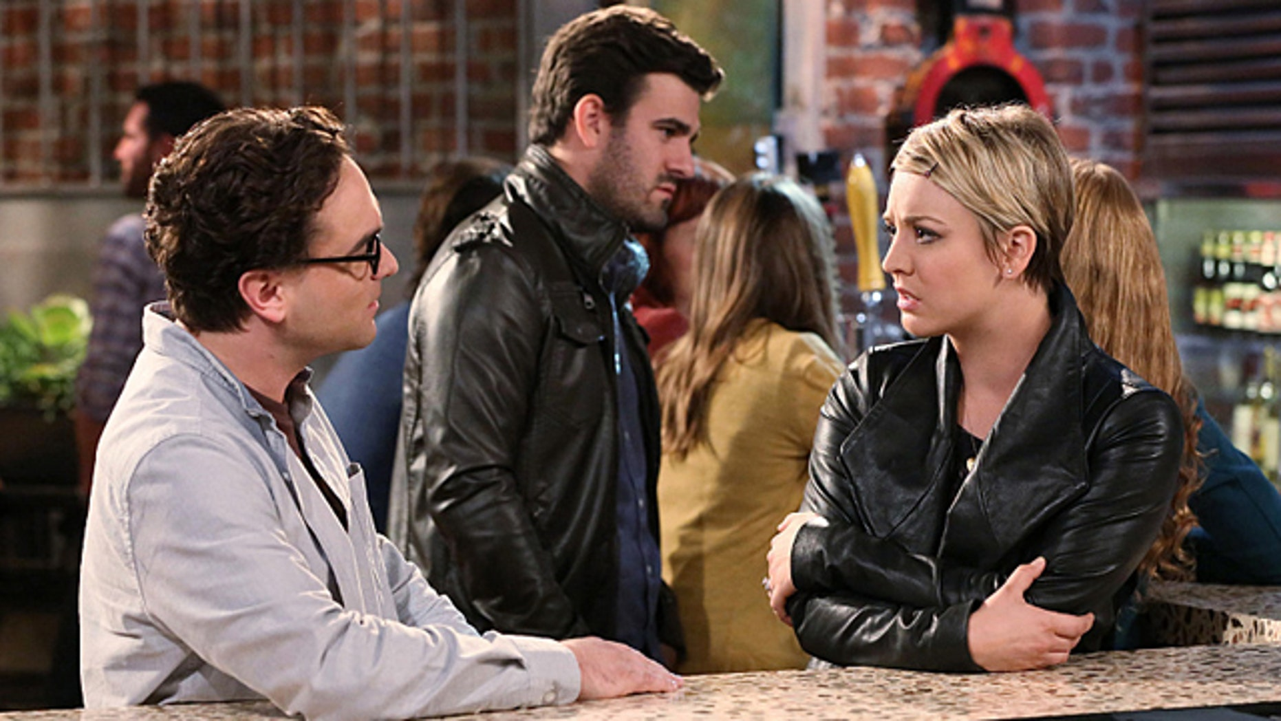Leonard (Johnny Galecki) and Penny (Kaley Cuoco-Sweeting) try to prove Sheldon wrong after he says that he and Amy are a 'superior couple' on 'The Big Bang Theory' (Michael Yarish/Warner Bros. Entertainment Inc.)