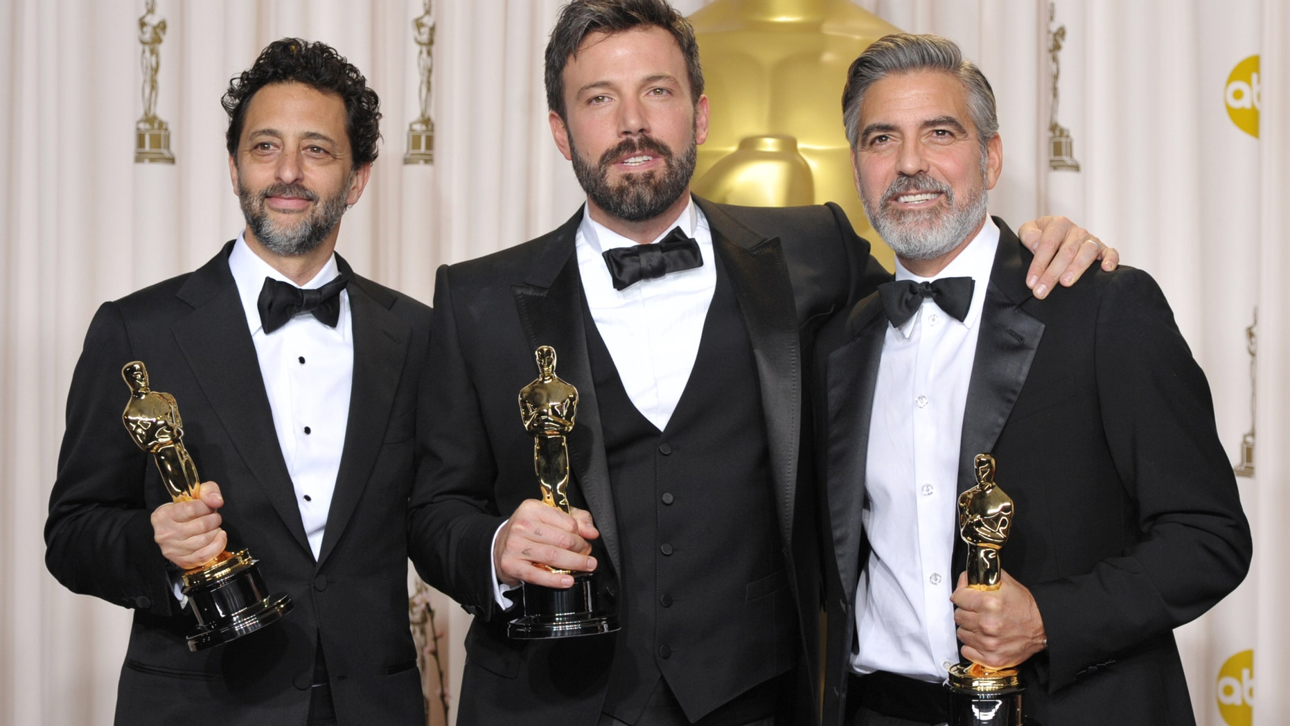 """Grant Heslov, from left, Ben Affleck, and George Clooney pose with their award for best picture for """"Argo"""" during the Oscars at the Dolby Theatre on Sunday Feb. 24, 2013, in Los Angeles."""