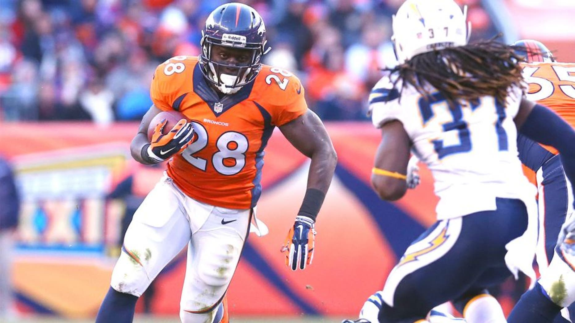 Jan 12, 2014; Denver, CO, USA; Denver Broncos running back Montee Ball (28) runs with the ball against San Diego Chargers safety Jahleel Addae (37) during the 2013 AFC divisional playoff football game at Sports Authority Field at Mile High. Mandatory Credit: Matthew Emmons-USA TODAY Sports
