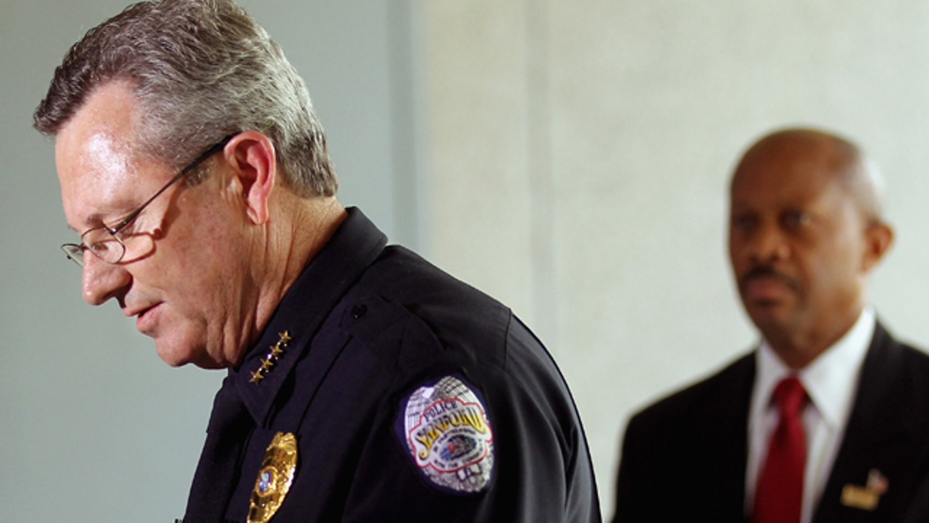 March 22, 2012:  Sanford Police Department Chief Bill Lee (L) speaks while announcing he will temporarily step down in the wake of the Trayvon Martin killing as Sanford city manager Norton Bonaparte Jr. (R) stands by  in Sanford, Florida.