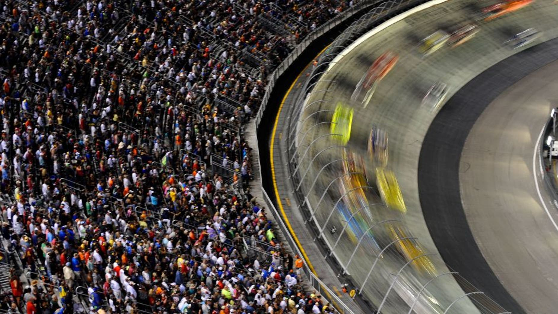 BRISTOL, TN - AUGUST 25: Cars race during the NASCAR Sprint Cup Series IRWIN Tools Night Race at Bristol Motor Speedway on August 25, 2012 in Bristol, Tennessee. (Photo by Jared C. Tilton/Getty Images)