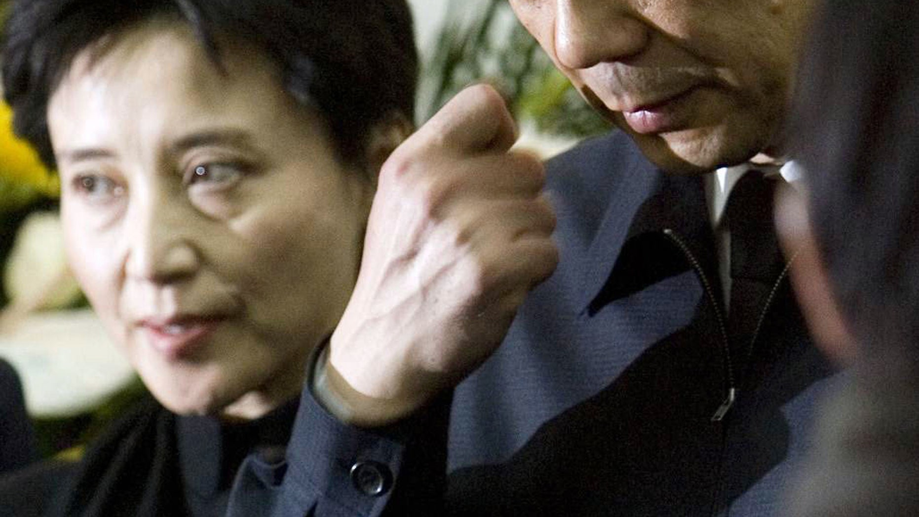 Jan. 17, 2007:  In this file photo, former Chongqing Communist Party Secretary Bo Xilai, right, accompanied by his wife Gu Kailai, attends a funeral for his father in Beijing.