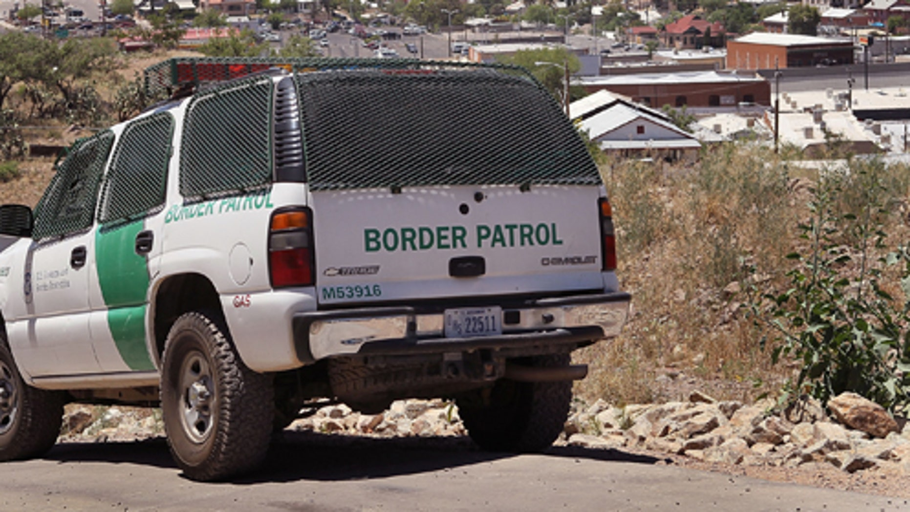 NOGALES, AZ - JUNE 01:  A Border Patrol agent patrols the border June 1, 2010 in Nogales, Arizona. During the 2009 fiscal year 540,865 undocumented immigrants were apprehended entering the United States illegally along the Mexican border, 241,000 of those were captured along this 262 mile stretch of the border known as the Tucson Sector.  (Photo by Scott Olson/Getty Images)