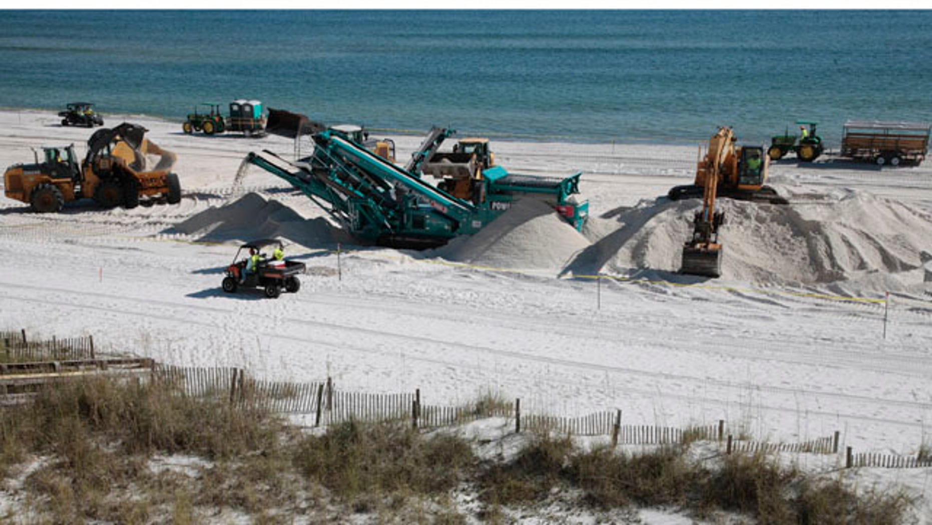 Nov. 9: BP performs a deep sand cleaning operation in Orange Beach, Ala.