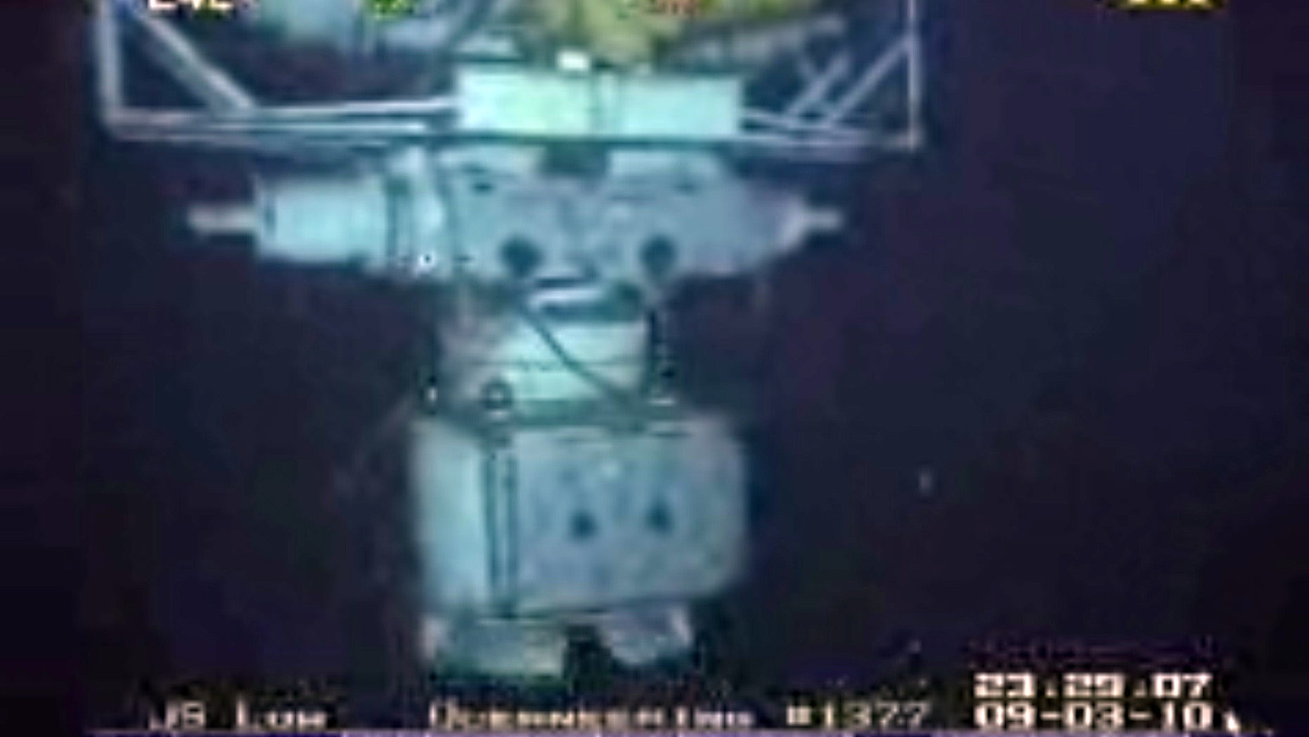 In this image taken from video provided by BP  PLC at 12:23 a.m. EDT, Saturday Sept. 4, 2010 shows the blowout preventer that failed to stop oil from spewing into the Gulf of Mexico being raised to the surface. The blowout preventer wasn't expected to reach the surface until Saturday, at which point government investigators will take possession of it.