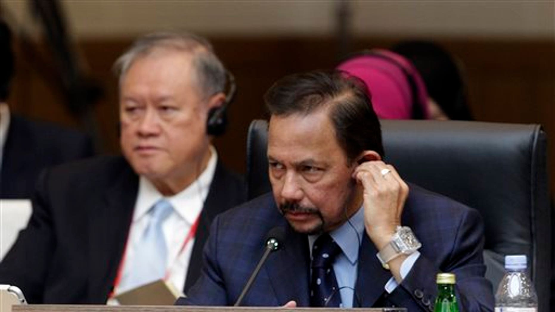 Brunei Sultan Hassanal Bolkiah attends the formal session of the ASEAN-Republic of Korea Commemorative Summit in Busan, South Korea, Friday, Dec. 12, 2014. (AP Photo/Ahn Young-joon, Pool)