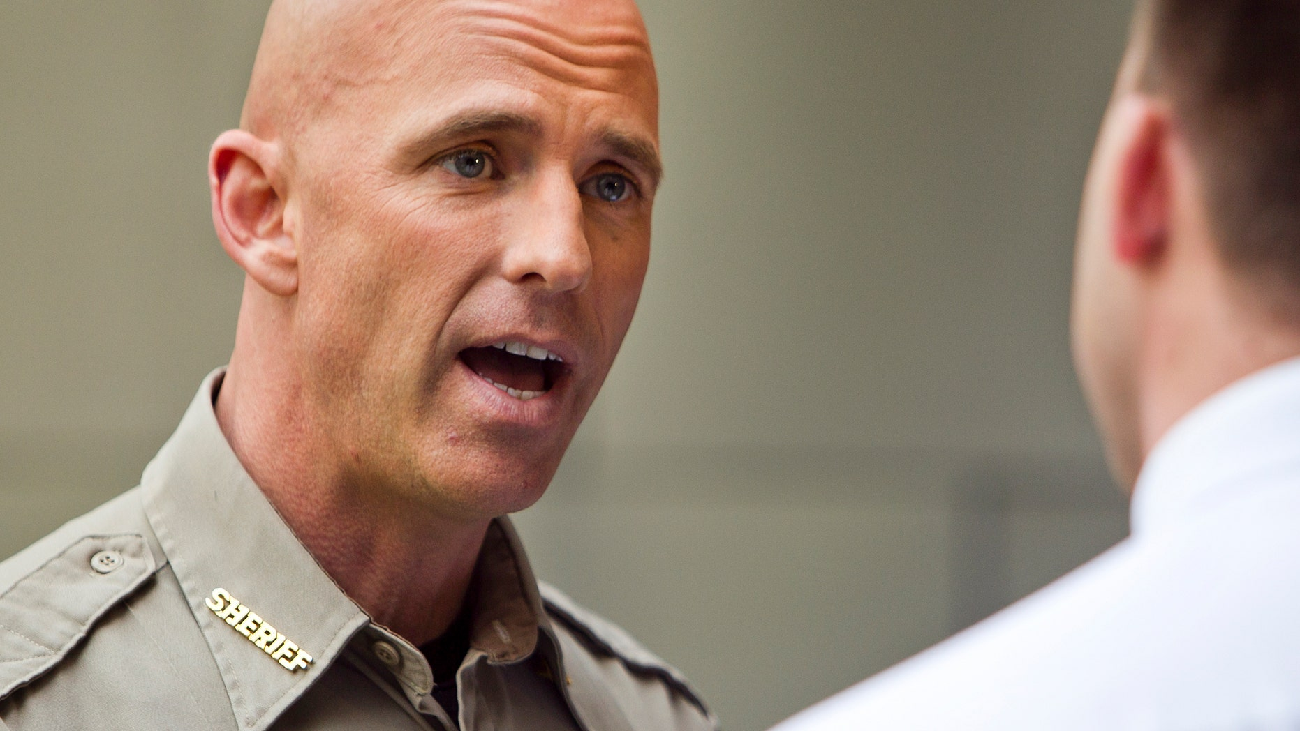 Pinal County Sheriff Sheriff Paul Babeu, left, is interviewed by KPNX reporter William Pitts at the Mesa Arts Center, Monday, Feb. 12, 2012 in Mesa, Ariz. (AP Photo/The Arizona Republic, Tom Tingle)