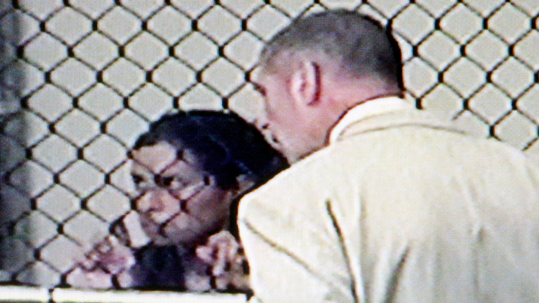 August 24: Sonia Hermosillo, 31, confers with her defense attorney at a video arraignment at the Santa Ana, California jail. Prosecutors say Hermosillo took off a special helmet that her son wore for a medical condition and tossed him over the edge of the parking structure at Children's Hospital of Orange County before validating her parking and driving away earlier this week. The boy died on Wednesday.