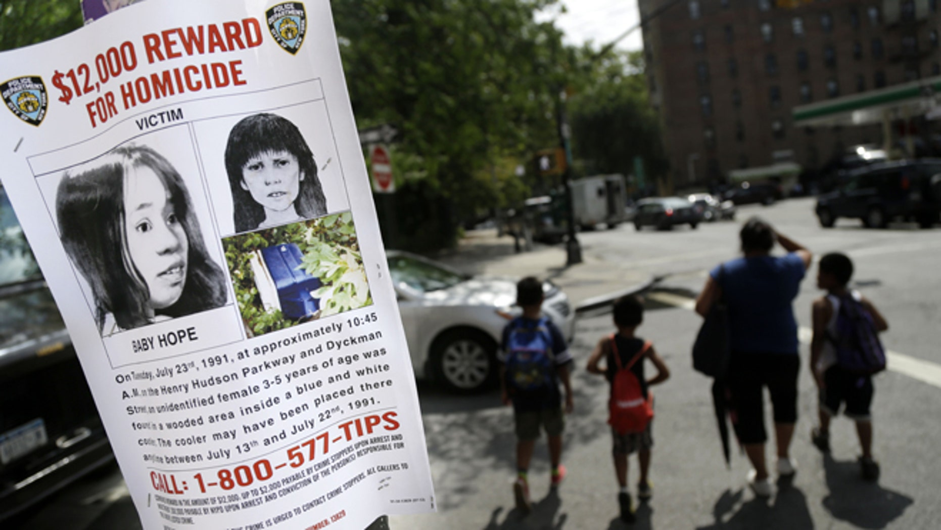 This Tuesday, July 23, 2013, photo shows a poster soliciting information regarding an unidentified body near the site where the body was found in New York.   (AP Photo/Seth Wenig)